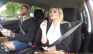 Huge-titted driving examiner Katy Jayne juggling on learners dick