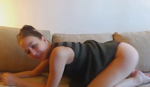 Cute girl farting on her couch